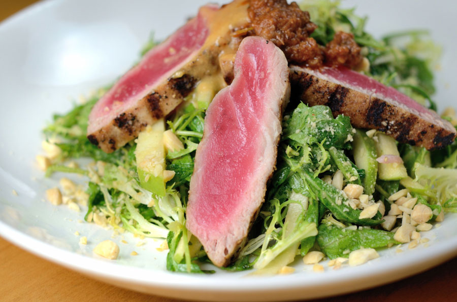 Ahi tuna salad with olive tapenade, arugula, almonds, green apple, miso vinaigrette