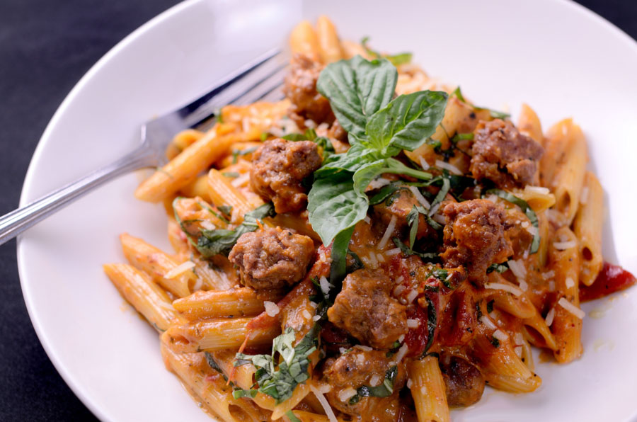Penne arabiatta with italian sausage, caramelized onions, piquillo peppers