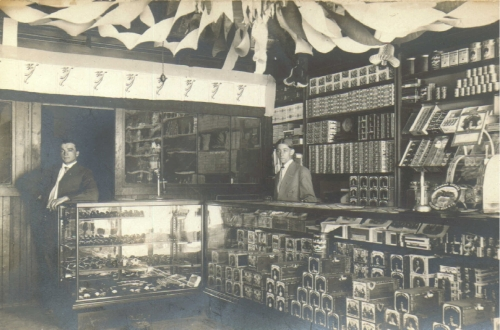 John J. Bartosh bought the Golden Eagle Cigar Store on July 1, 1907 (pictured above, John left, brother George right).
