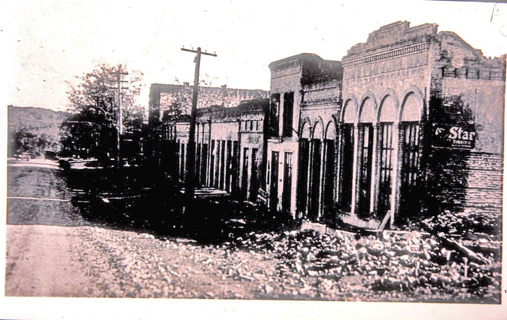 The ruins in Shasta in the 1920's: Voluntine's place was the last building on the right, which is no longer standing.