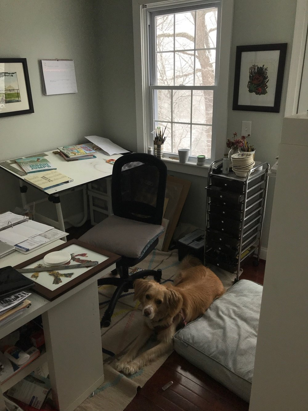 Shadra's studio space in Baltimore, and her sweet dog, Lucky (image courtesy of Shadra).