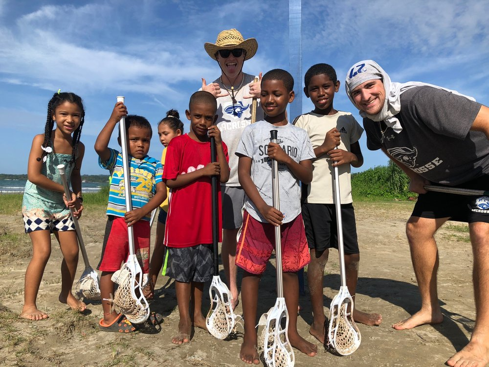 Will and CNU teammate, Miles, coaching some beach lax in Bocas.