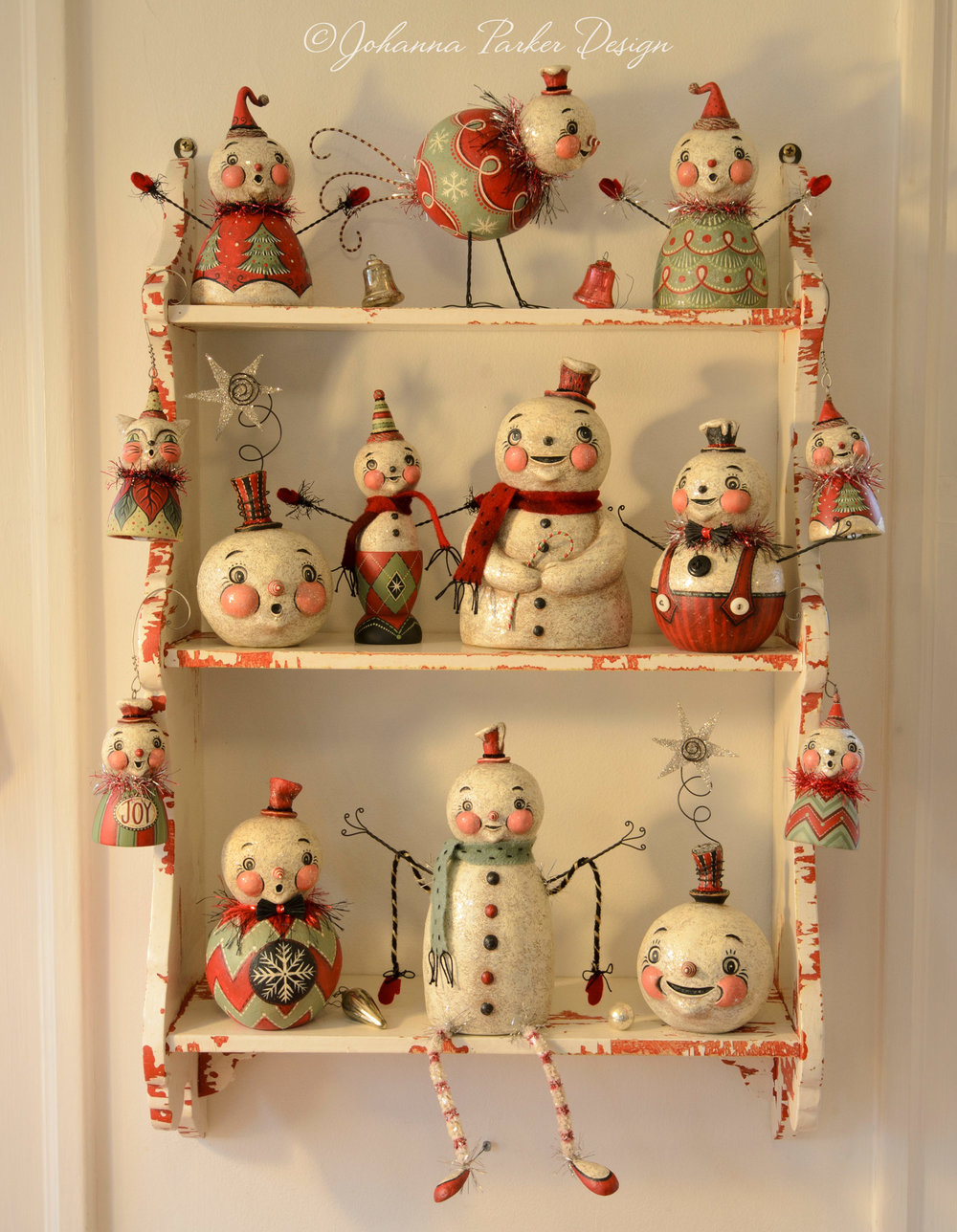 Holiday folk art shelf collection