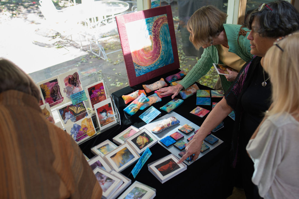 Ann Lederer points out her handmade cards while an attendee caresses her lavender-filled eye pillow, all made of painted silk. They smelled divine too...
