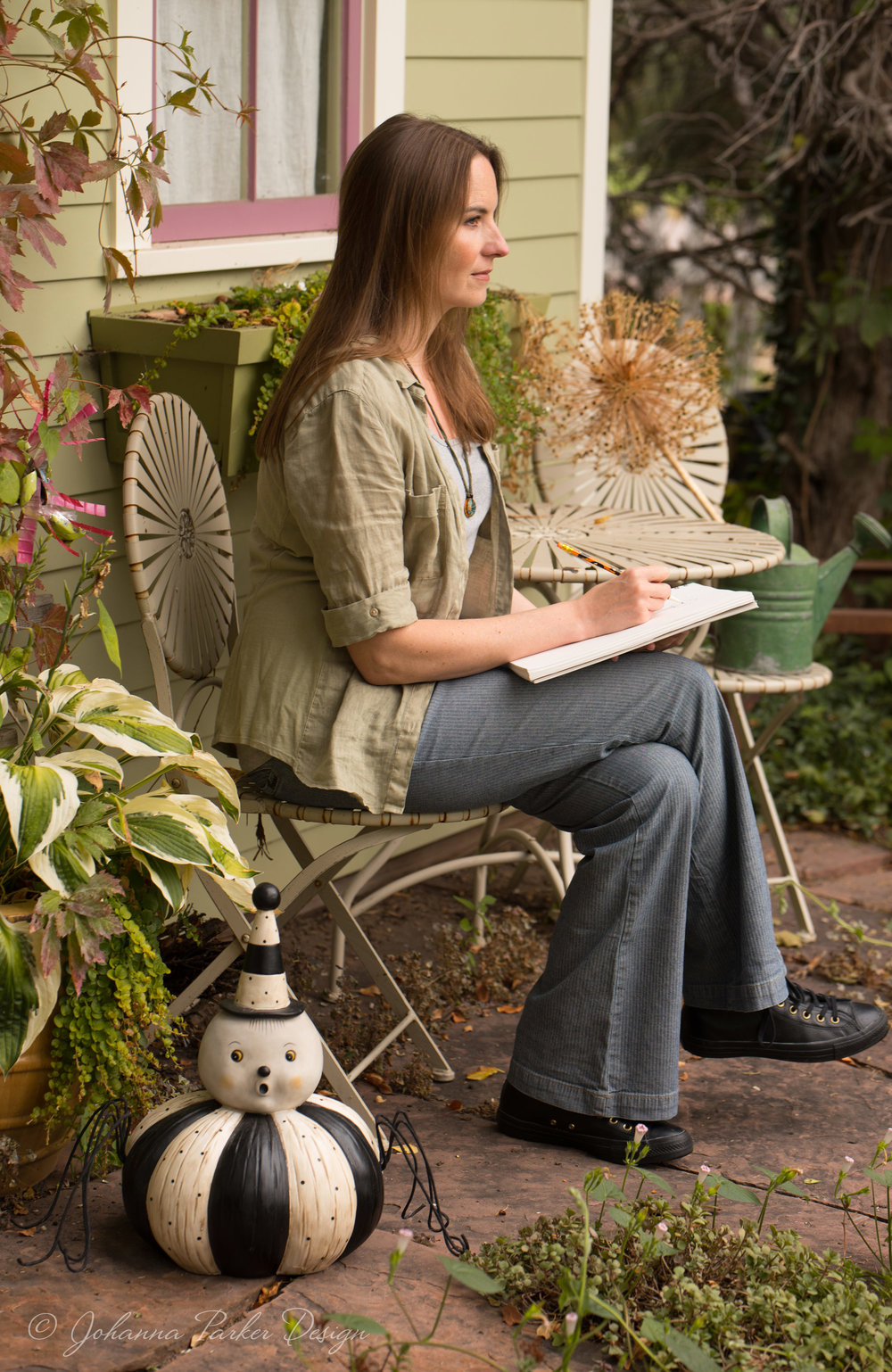 Me again at a little backyard garden table, staring off into imaginary land like I often do... Giant spider in tow....This feature was so last minute, I didn't have time to iron my clothes. Bad weather was rolling in, and we just had to wing it... I rarely iron anyway....  :D