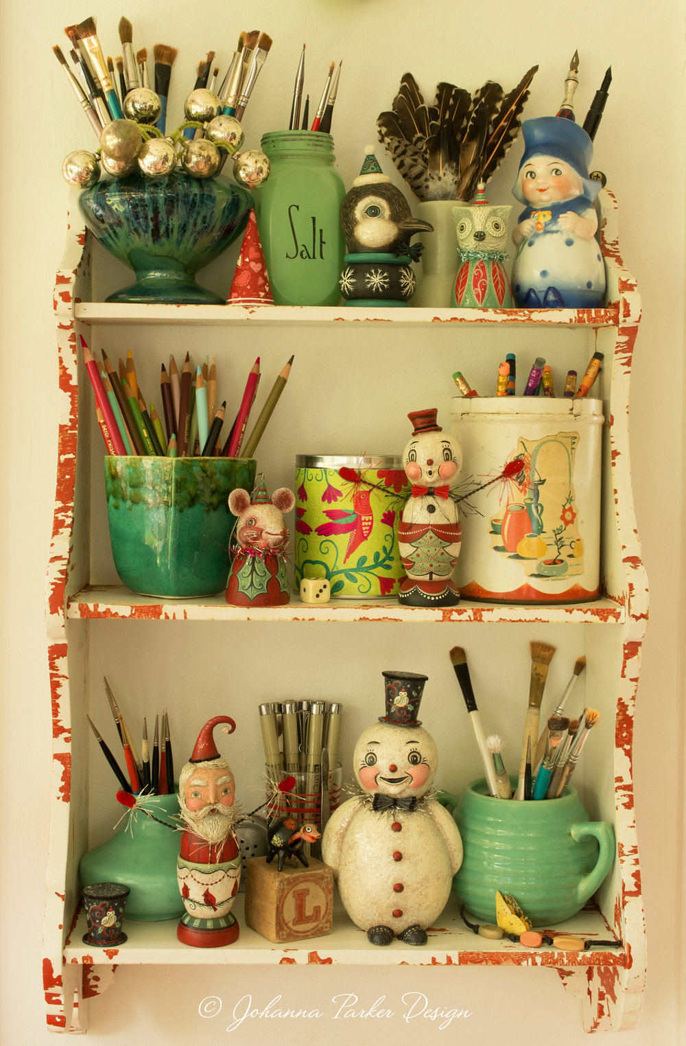 An old family shelf now houses both art supplies and one of a kind folk art pieces.