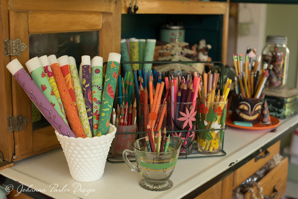 A hand-me-down hoosier hutch from mom is now the keeper of art supplies, fabric swatches & collectibles that inspire new designs.