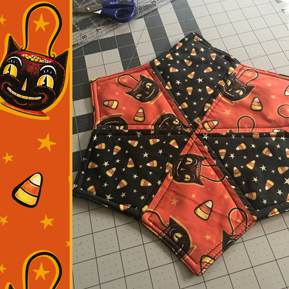 "Work in progress quilted star by @misschristinagrant (on Instagram) using Johanna Parker Halloween fabric from Spoonflower.  GET: ""Trick or Treat Black Cat"""