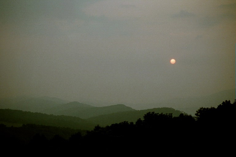 A hazy sunrise from atop Smith Knob of Allegheny Mtn - By Doug Wood