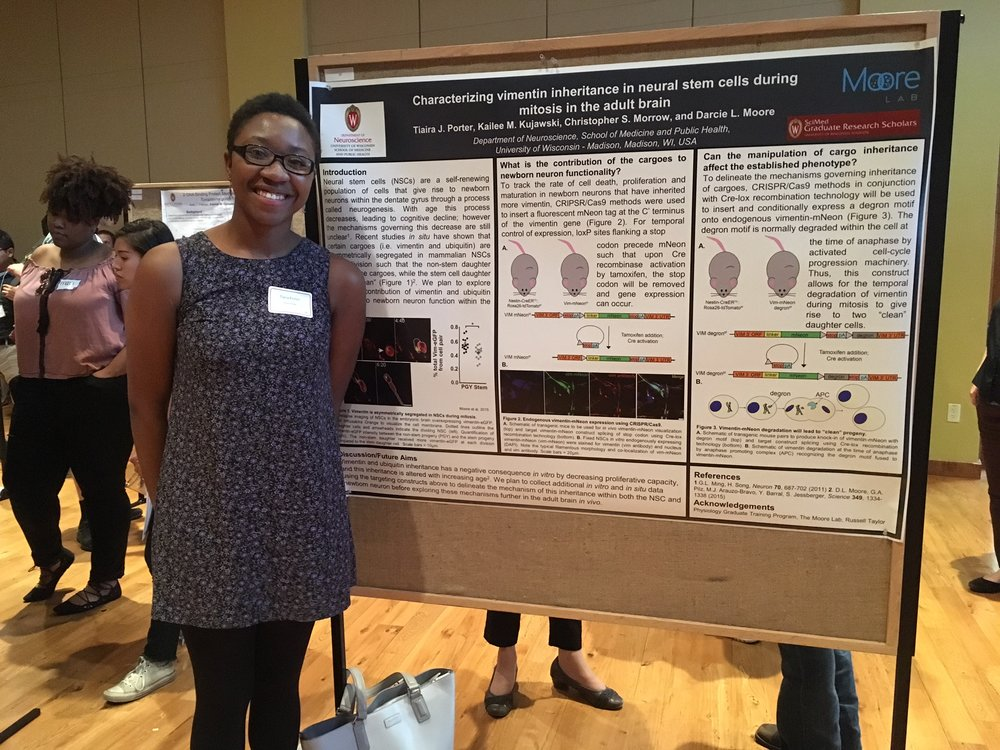 Tiaira presents her SciMed poster. First lab poster!