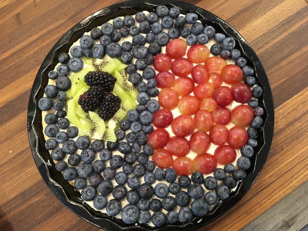 A fruit pizza - Vimentin (kiwi), Protein aggregates (blackberries), Nucleus (grapes), Cytoplasm (blackberries)
