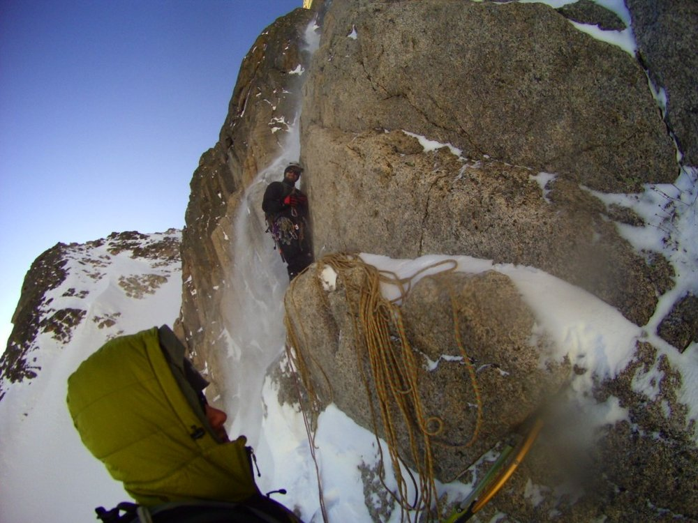 "The author at one of his many ""homes."" East Face of Long's peak during a winter ascent of Alexander's Chimney"