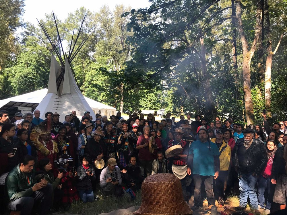 Lighting of the sacred fire.   Nisqually tribal councilman Hanford McCloud lights the 17th sacred fire. The coals of the sacred fire have been carried since the first Protecting Mother Earth conference in 1990.
