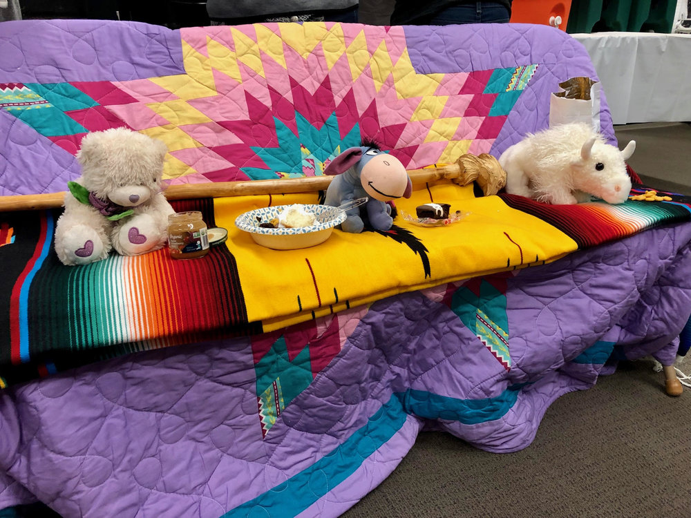Stuffed animals and treats were laid out on blanketed chairs to show love and concern for Indigenous children lost to the the child-welfare system.