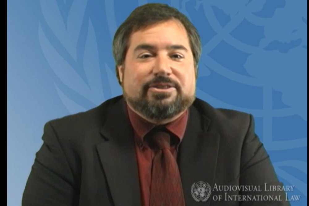 Michael Scharf on UN TV discussing maintaining control of war crime trials.