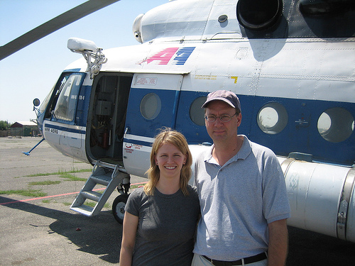Paul and Meghan in front of a helicopter_Armenia.jpg