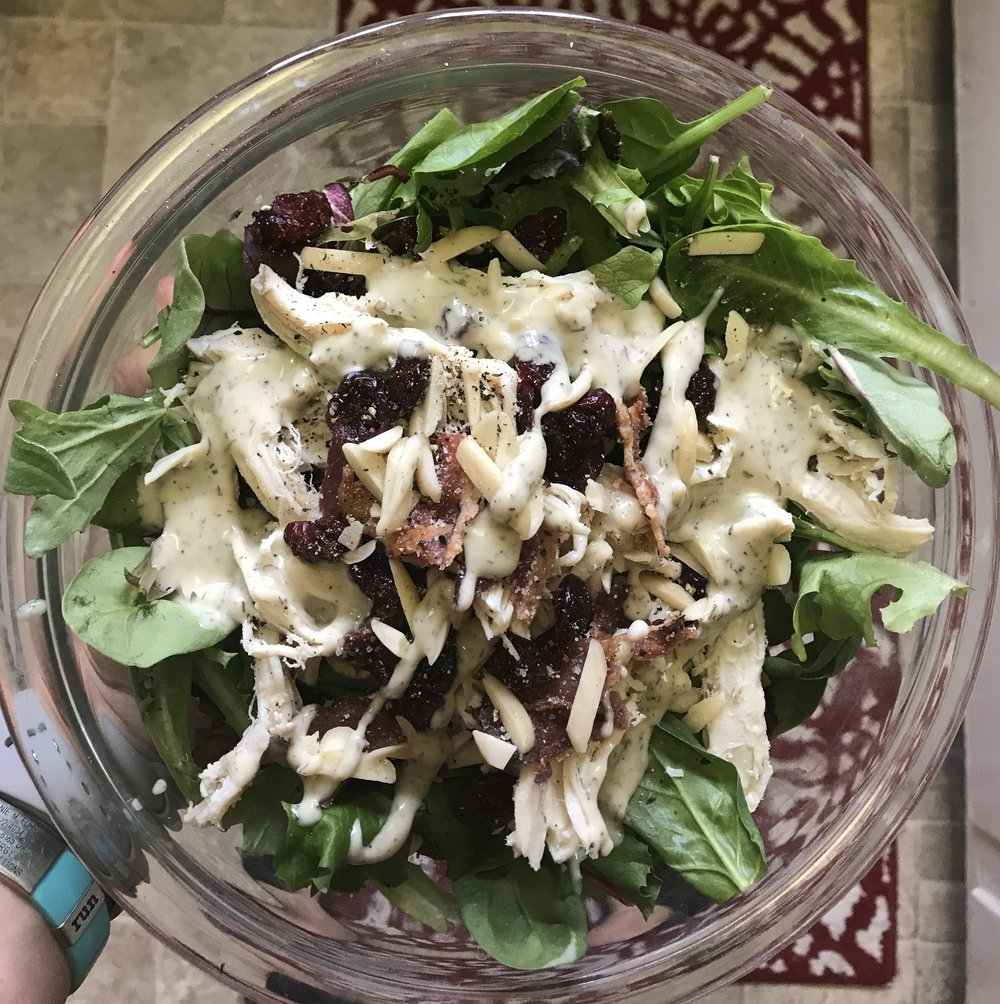 Salad on repeat this summer; mixed green, bacon, dried cranberries and chicken drenched in Tessamae's Creamy Ranch