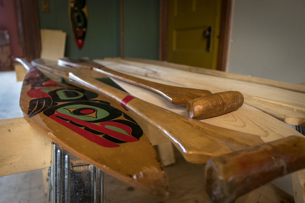 Once the paddles are carved, they are then decorated in traditional paintings and then preserved with varnish.