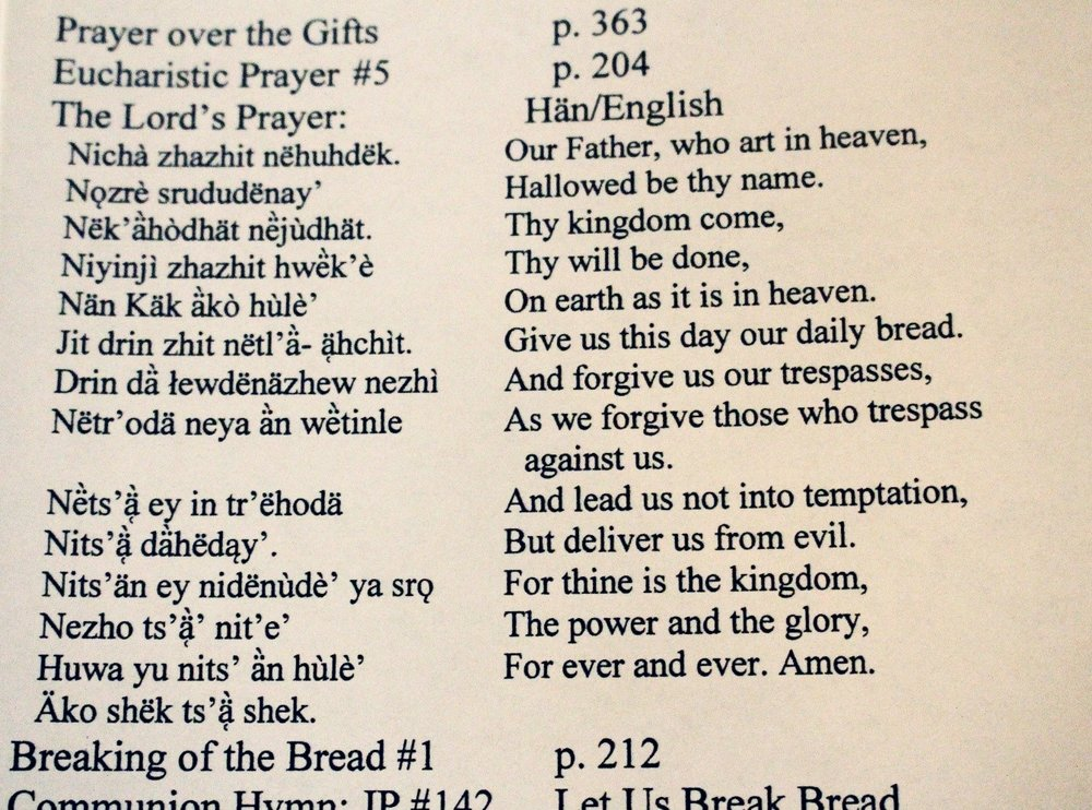Part of the bulletin handed out at St. Paul's Anglican Church in Dawson City – it contains The Lord's Prayer in Han & English. Photo by Amy Burlock.