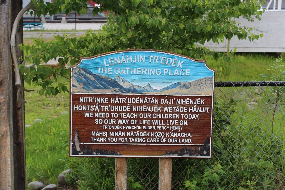 "A sign entitled ""The Gathering Place"" stands outside the Robert Service school in Dawson city. It contains a quote about the importance of teaching children from Tr'ondek Hwech'in Elder Percy Henry. Photo by Amy Burlock."