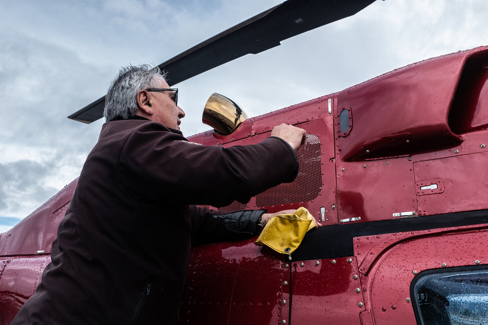 Washington cleans and inspects his helicopters before every flight. He says the process can take between 20 to 40 minutes, depending on the flight schedule of that day.