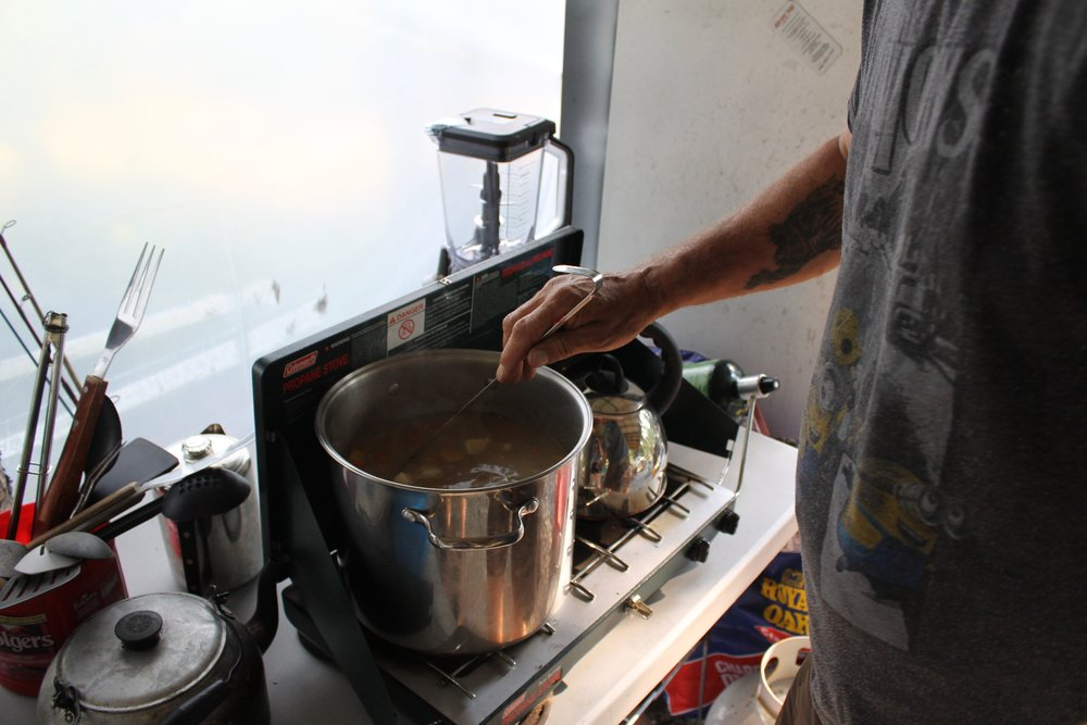 Stew boils on the stove and the smell of bannock wafts throughout Dorothy Sam's outdoor kitchen at her family's fish camp. Photos by Kiera Kowalski