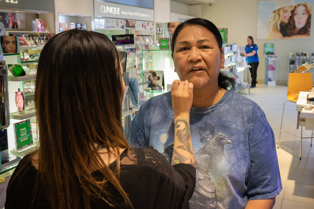 "Akiko Allen, a makeup artist at a Shoppers Drug Mart in Whitehorse, applies makeup to Ronnie's face. Not so long ago, Ronnie didn't have a clue how to use beauty products. ""I met her one day (in the store) and I said, 'can you keep a secret, until I learn?',"" recounted Ronnie.  ""She said 'Hey! As long as you're comfortable in your own skin, that's fine by me.' And we became good friends!"" Photo by Adam van der Zwan."