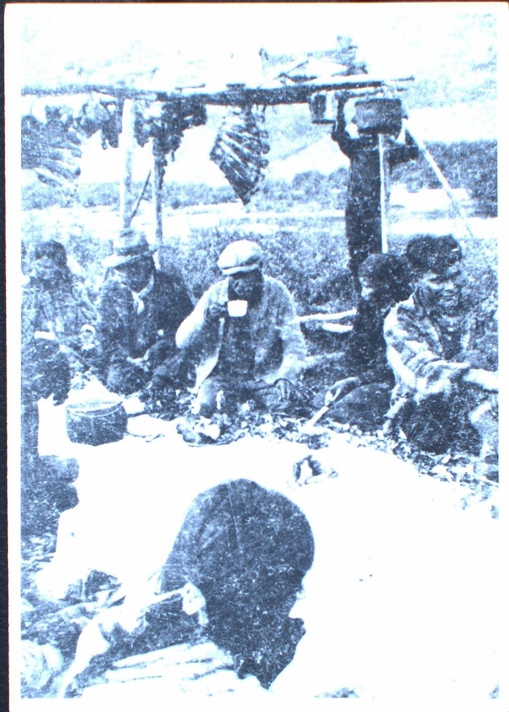Caribou meat hangs at a potlatch at Coffee Creek, down the river from Fort Selkirk, in 1930. Photo by David Silas. Courtesy of Yukon Archives, Their Own Yukon Project collection 2000/37 #192