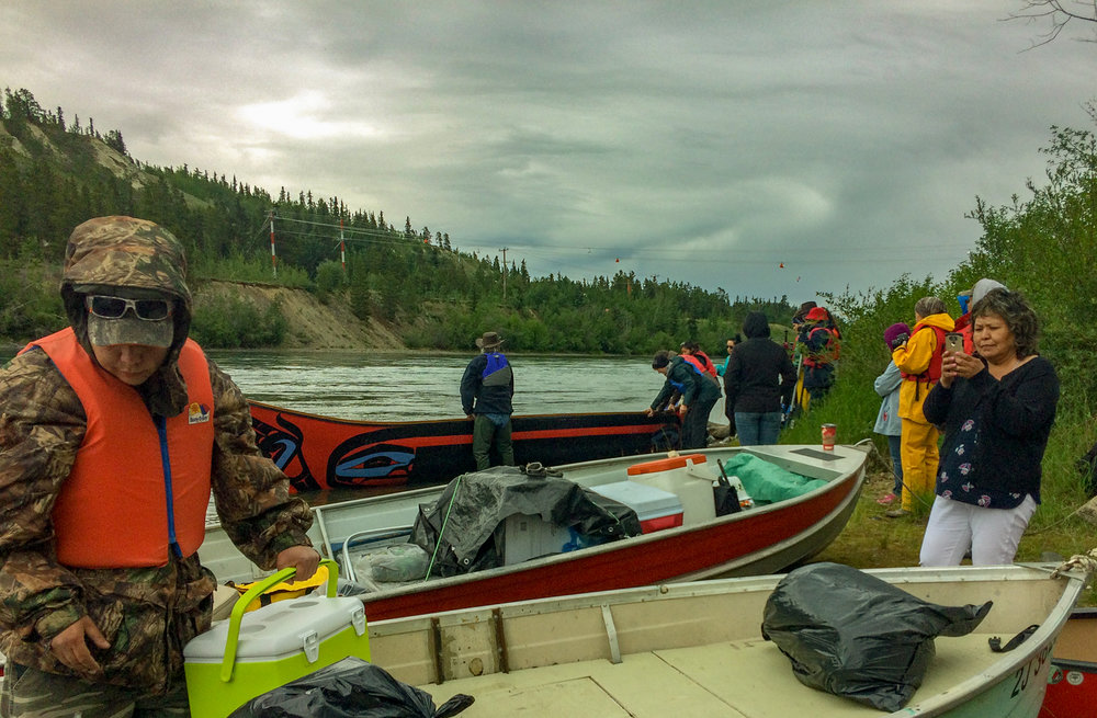 The dugout canoe (back) along with several two-person canoes are set up for the 10-day trip down the Yukon River. The trip began July 19, 2018.