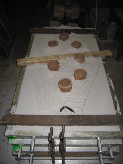 Sand casting with filler/air tubes