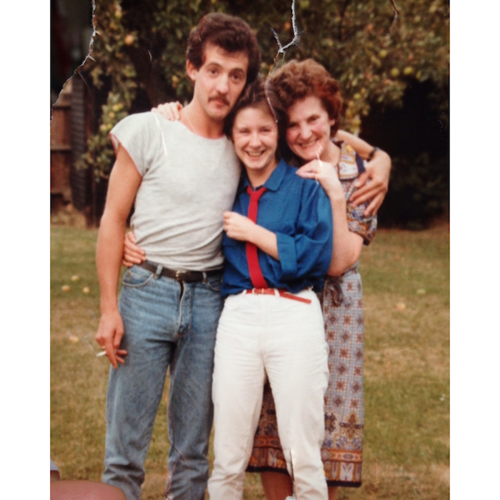 1984: My mum wearing a red tie styled with a blue shirt & white jeans.