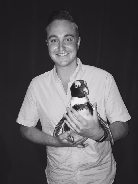 Holding Aurora the 3 1/2 year old African Penguin.