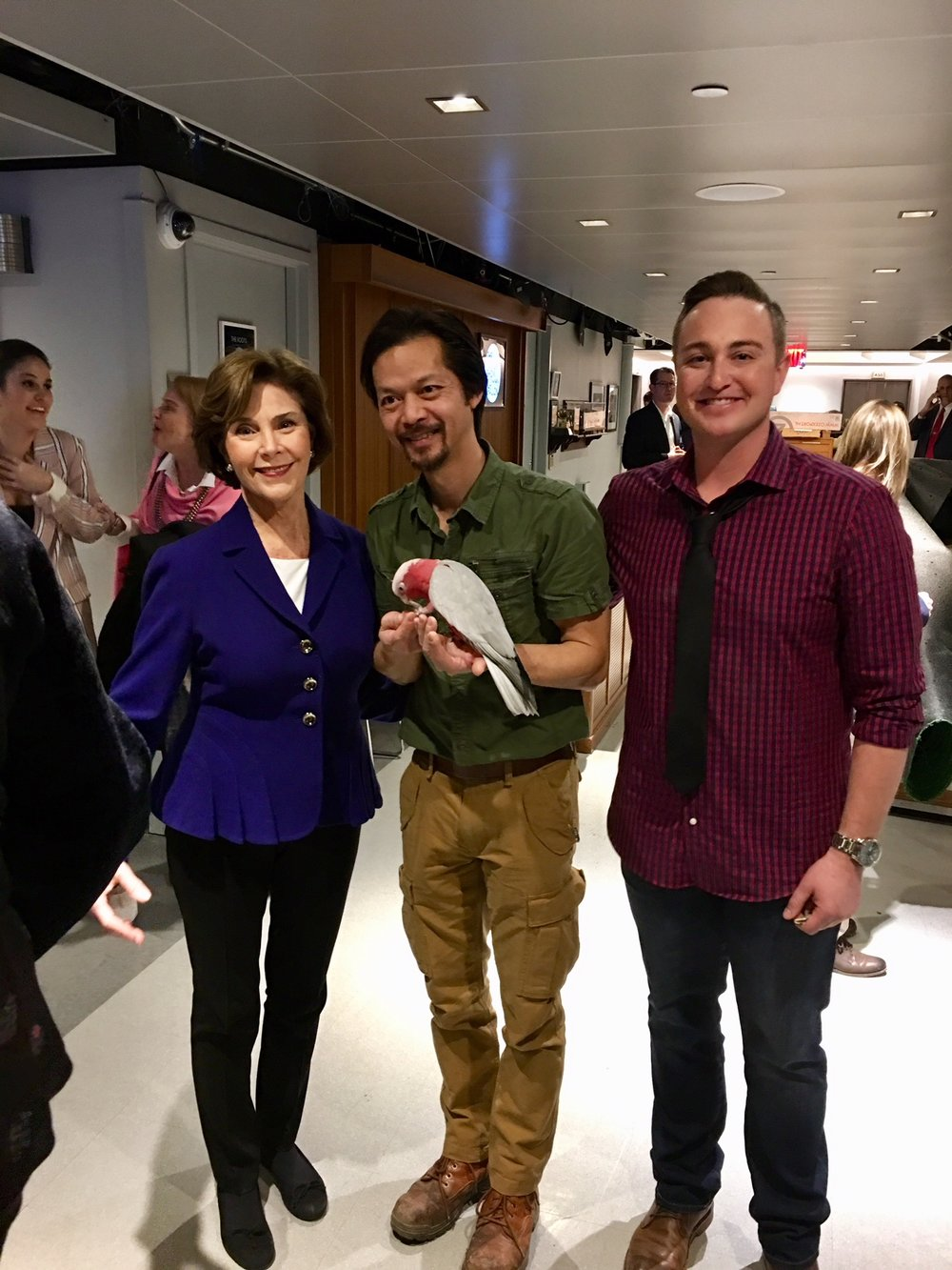 Former First Lady Laura Bush, Bird Trainer Phung Luu with a Rose-breasted Cockatoo, and Me.