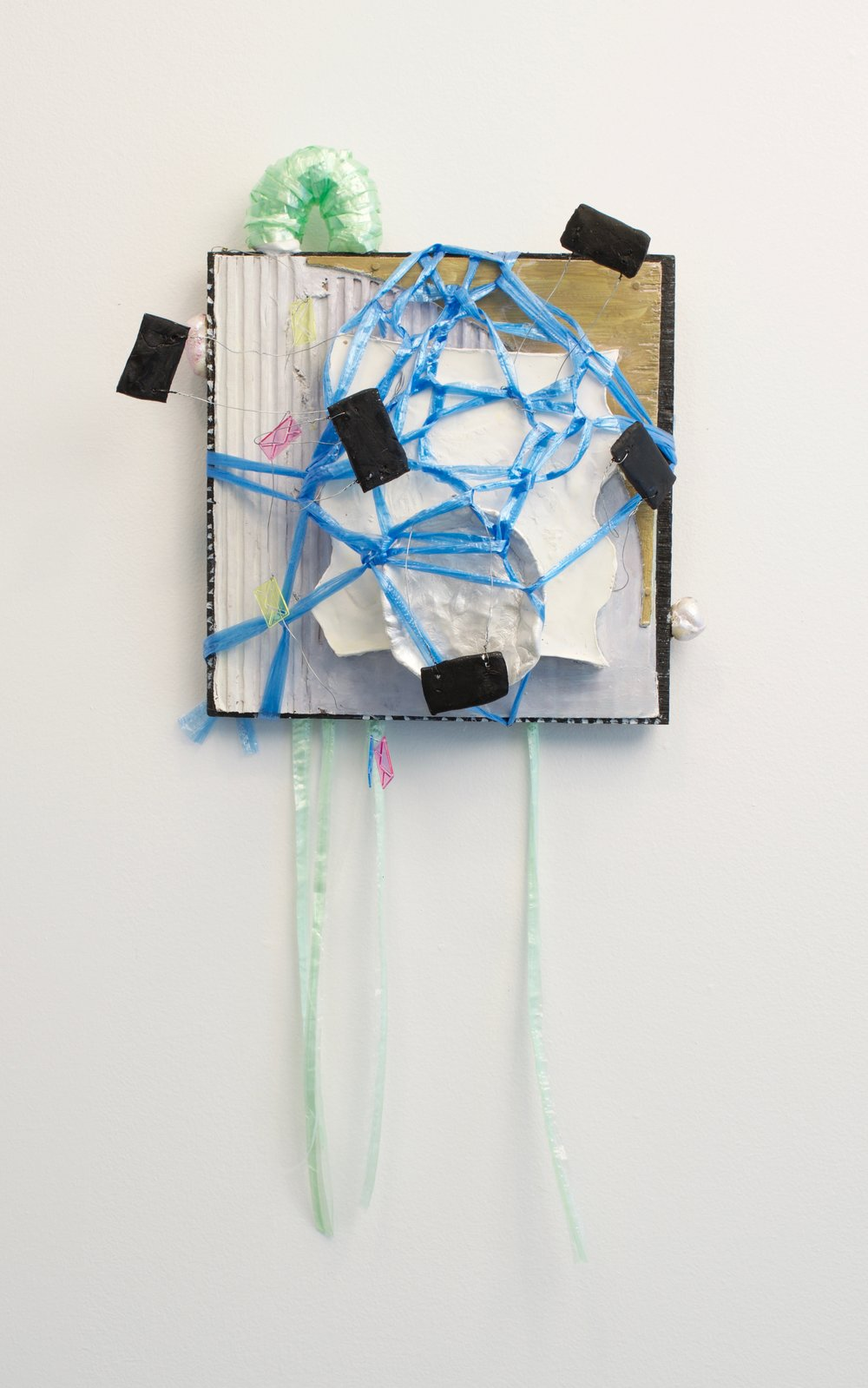 Fukuko Harris, Mardi Gras, 2016. Plaster, Clay, Synthetic Strings, Paper Clips, and Foam on Canvas. 12 x 14 inches.