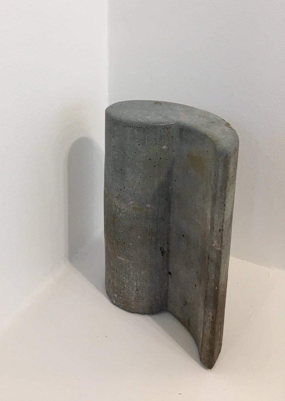 "Laura Kaufman, ""Rose Comma"", 2012/2018. Concrete, soil. 7x5.5x3 in."