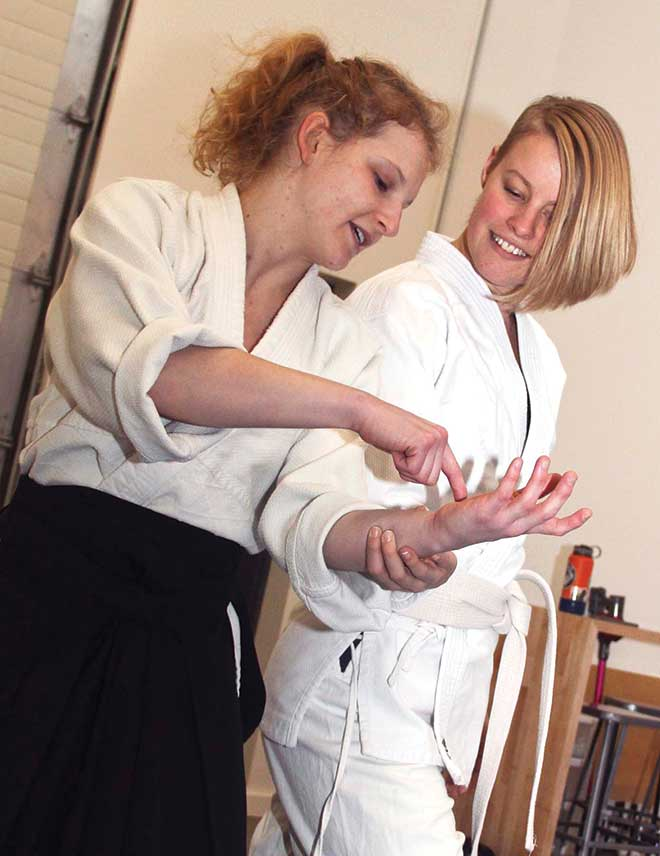 SomethingNew_Aikido_Megan-learns-grip_1752_JB.jpg