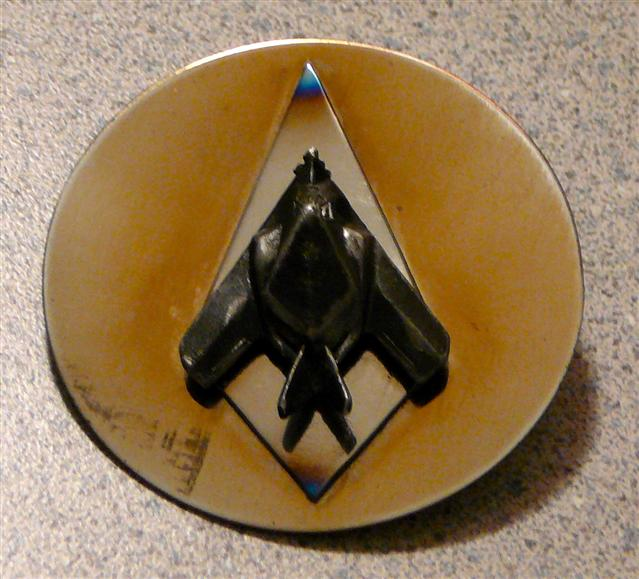 1988, during a meeting with a Lockheed Technical Engineer and after performing some tedious precision measuring task on some unknown black aircraft parts, I was given this small lapel pin in the shape of a strange looking aircraft.