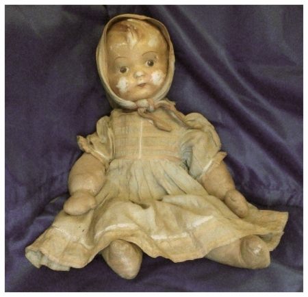 Tutti's doll that her father used to hide money