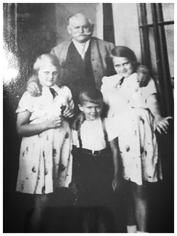 My mother (left), her younger brother and older sister with their father. 1939