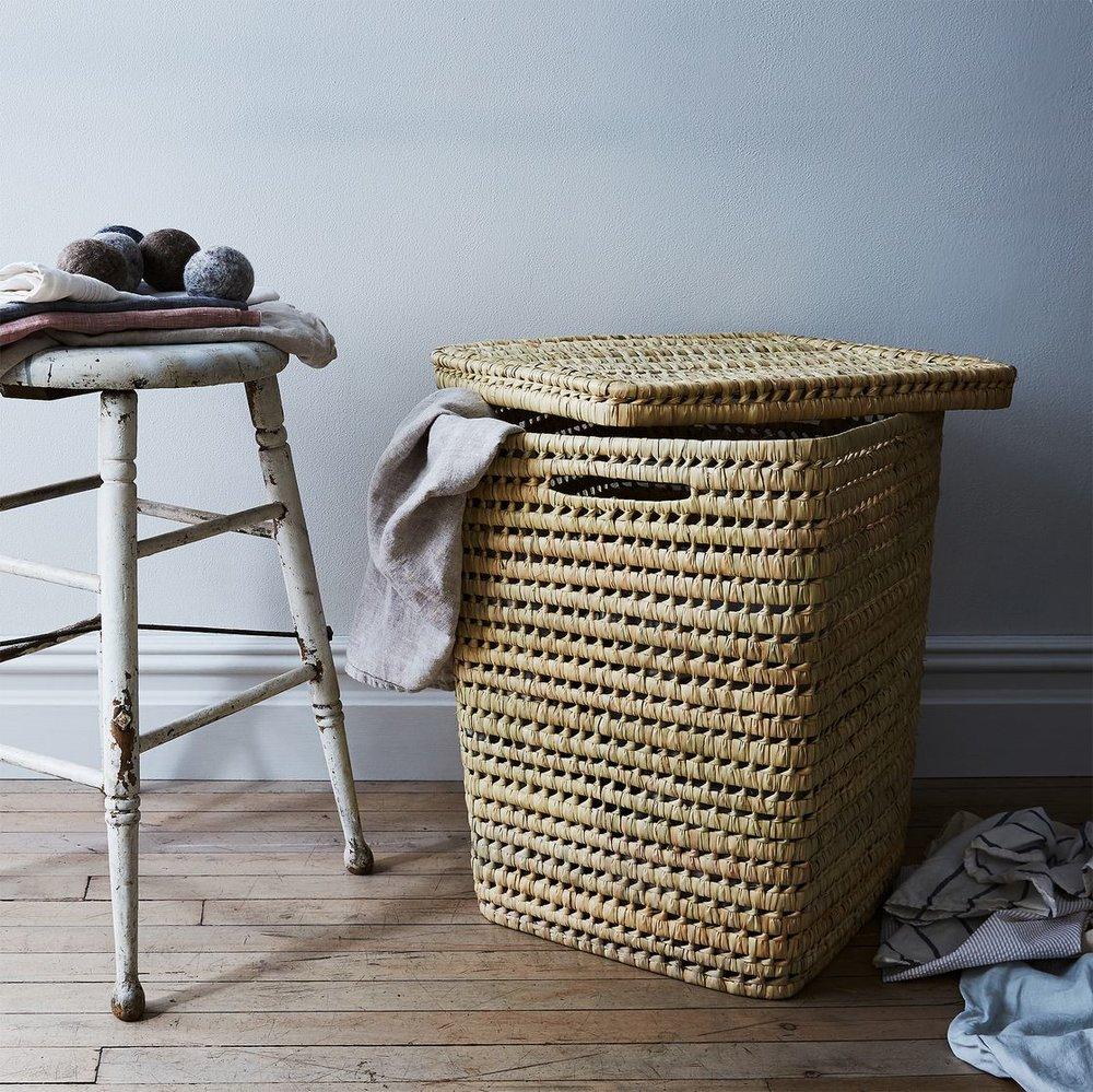 31249112-5d37-47f4-8cf3-76f1516cd308--2017-0605_hawkins-new-york-food52_woven-moroccan-laundry-baskets-with-lid_mid_bobbi-lin_27746.jpg