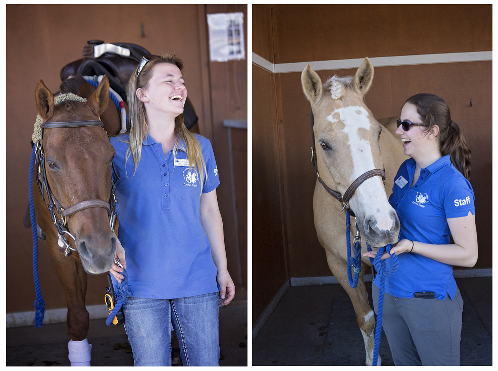 Two staff members, Ariel and Emily, with happy smiles. Ariel and Emily are each leading a horse.