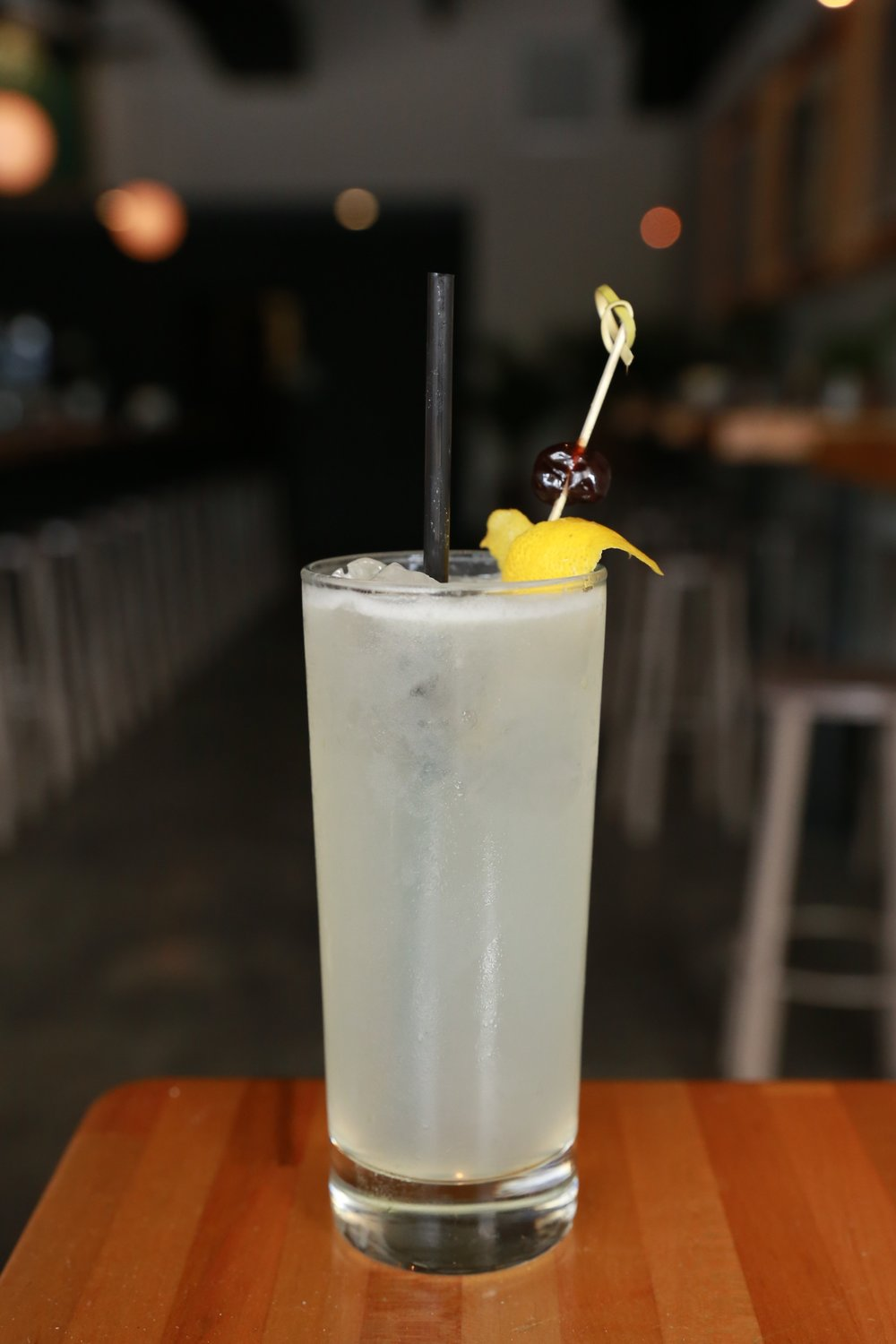 Tom Collins - Hayman's Old Tom Gin, Lemon, Sugar, Soda Water, Cherry. Light and just a little tart.