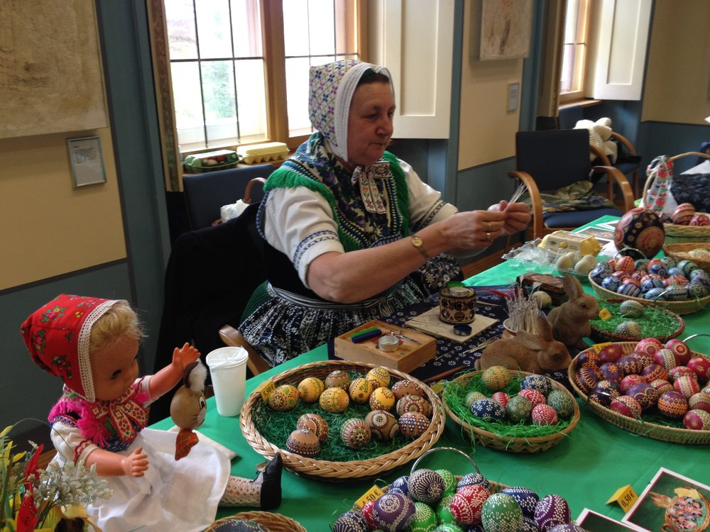 A Sorb woman selling merch at a local museum in Brandenburg.