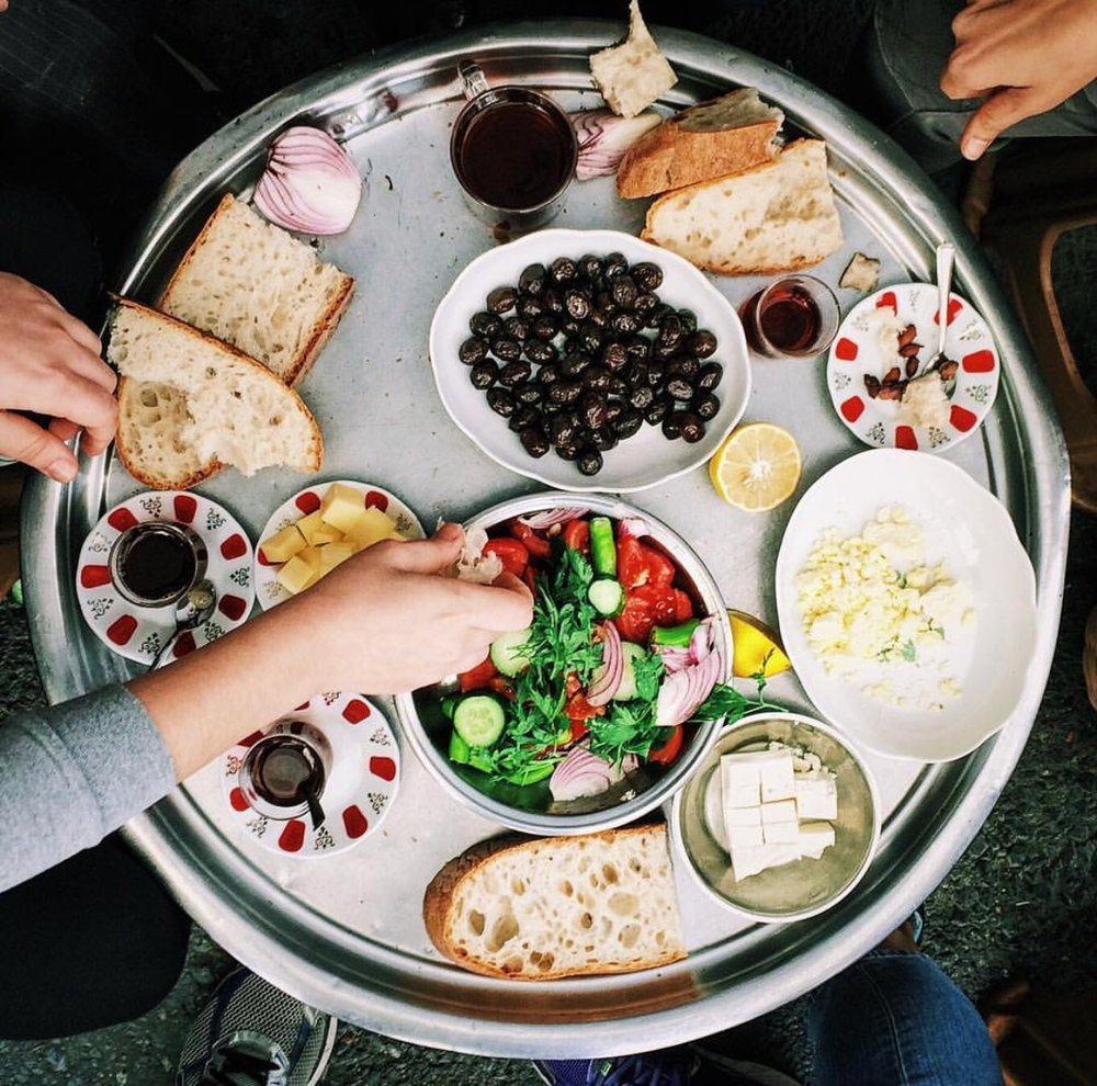 As a member of Team Savory, rather than Sweet, I love that a traditional Turkish breakfast involves cucumbers, olives, cheeses, and bread. Team Sweet can take comfort in the jams.
