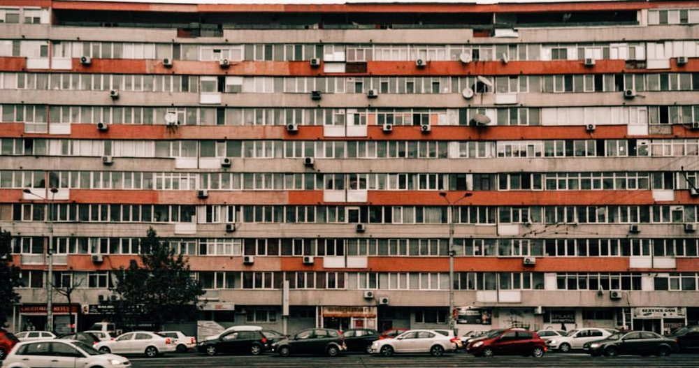 """Communist block. Due to Dictator Ceausescu's overzealous development, Bucharest's architecture is a real mishmash. """"You'll find an ugly Communist block next to a beautiful art deco villa that survived,"""" says journalist Debbie Stowe."""