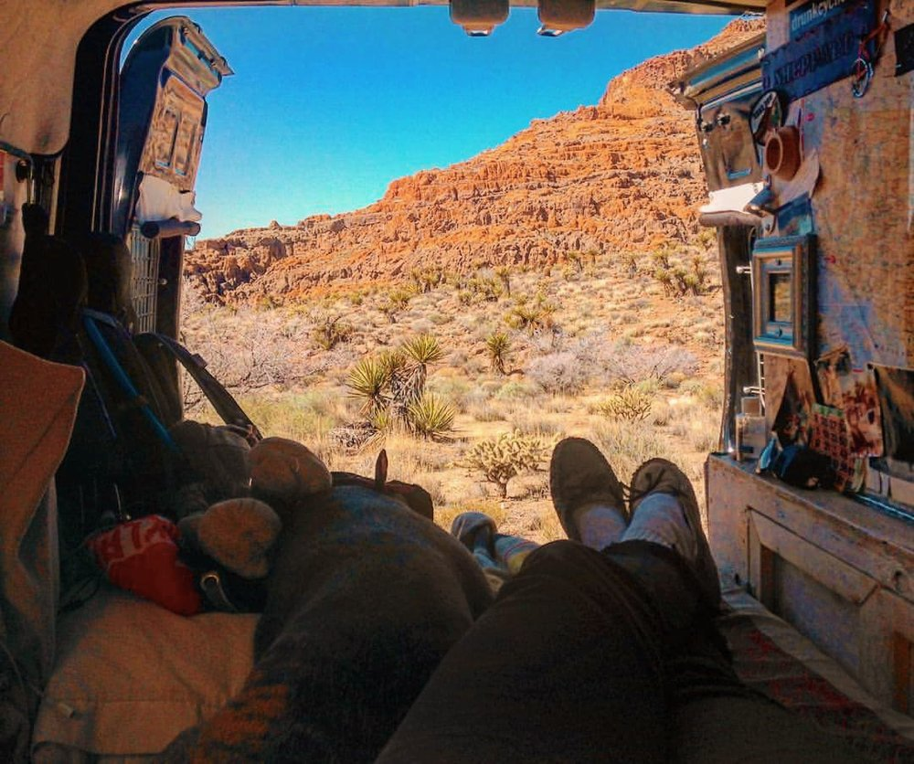 Casey kicking back inside her van and enjoying van views.