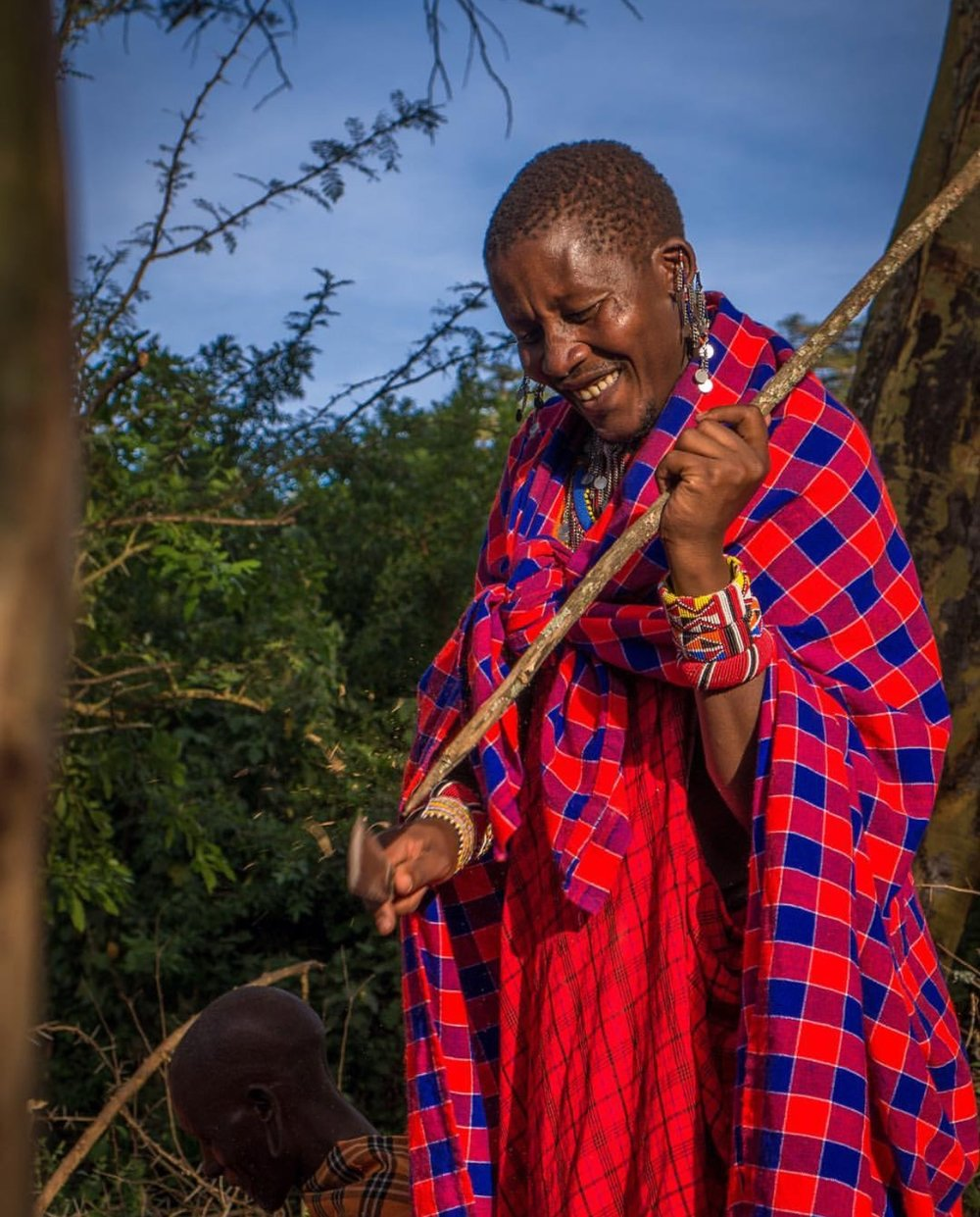 Salaton Ole Ntutu, the Maasai warrior chief of Maji Moto in Kenya, developed a social enterprise that allows travelers to stay with and learn from the Maasai people and their culture in a socially responsible way. Money from the tours helps fund his work to end female genital mutilation.  Photo by Shannon O'Donnell .