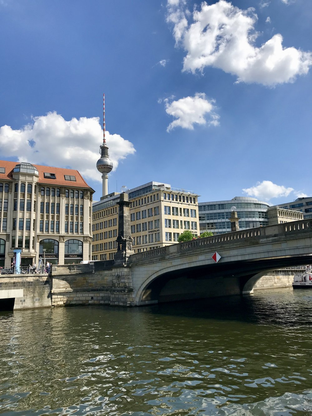On a sunny day, cruise along the river Spree. You can eat dinner in the TV Tower you see in the background. It rotates every 30 minutes.