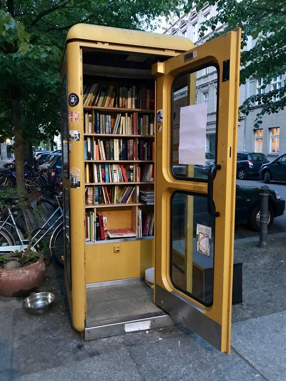 Give a book, take a book at this random library. I've seen these in London, too, and love that old phone booths can be used for something other than advertisements for sex hotlines.