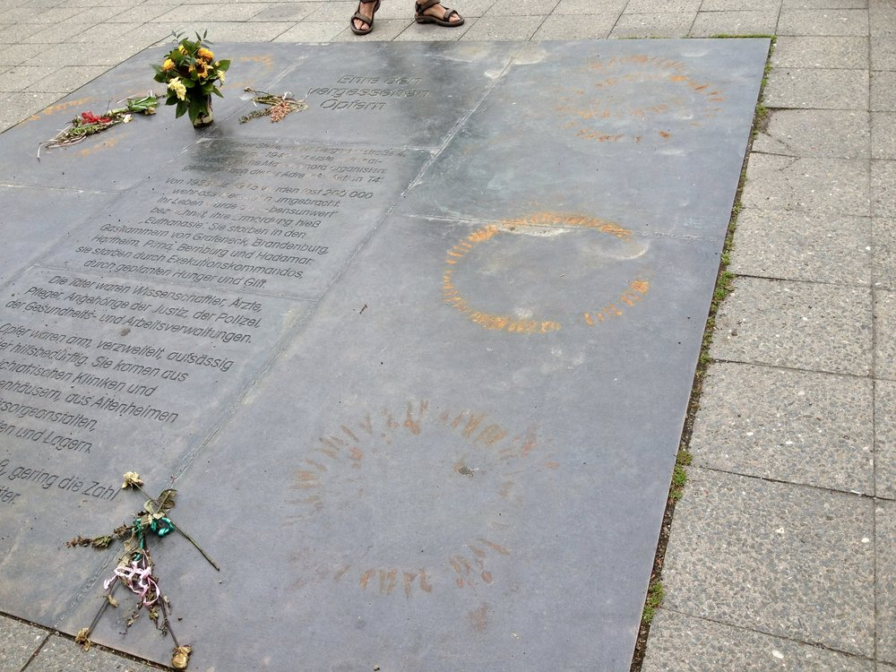 "This spot commemorates the victims of Aktion T4. The description: ""From 1939 to 1941 the Nazis carried out a secret mass murder programme code-named 'Aktion T4.' Most of the victims–men, women, and children–were mentally ill or disabled. Under the Nazi ideology of a racially pure and healthy nation, they were considered 'unfit to live'…At least 200,000 people were murdered in Aktion T4 and other Nazi 'euthanasia' programmes. There were no survivors. Many of the perpetrators escaped prosecution and were able to continue their professional careers."""
